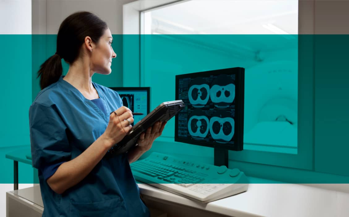 Woman radiologist viewing lung CT scans on video monitor